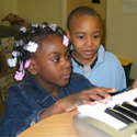 Daejanay and Sterling (both 6 years old) improvising on keyboard, photo by Sarah Greene 2004
